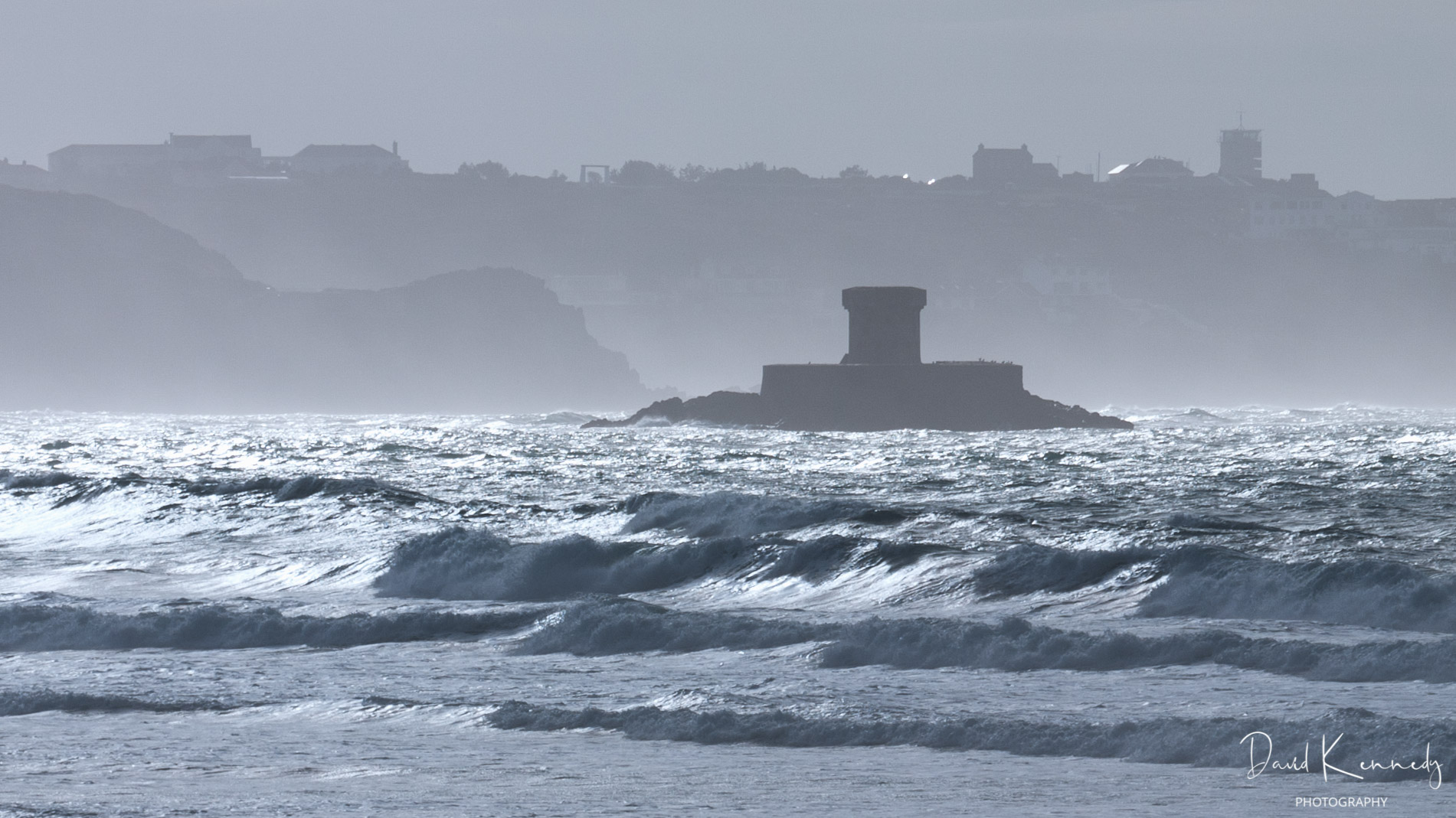 Napoleonic era defence tower on a rock in a lively sea