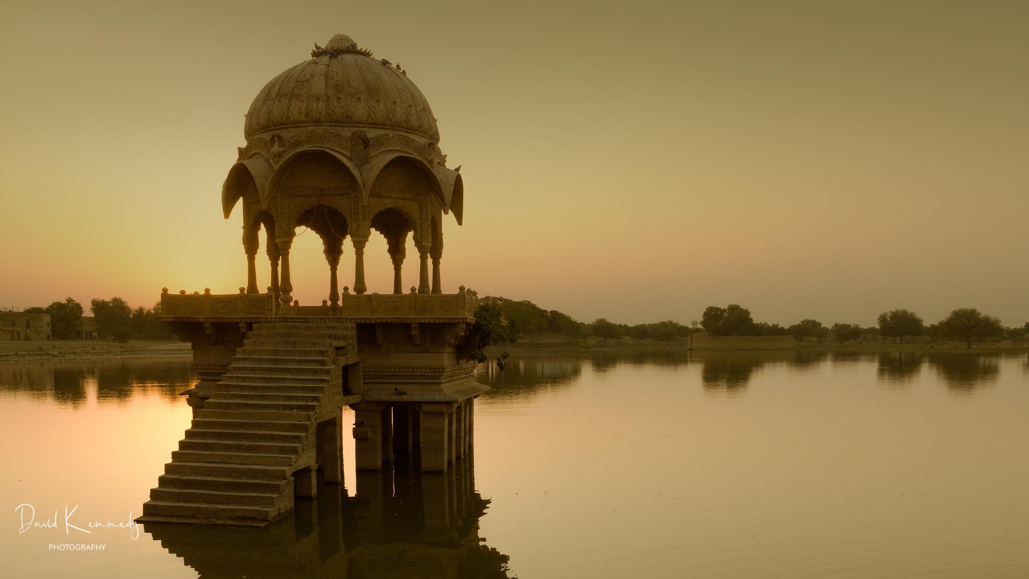 Ornate platform in Gadisar Lake in India at Sunrise