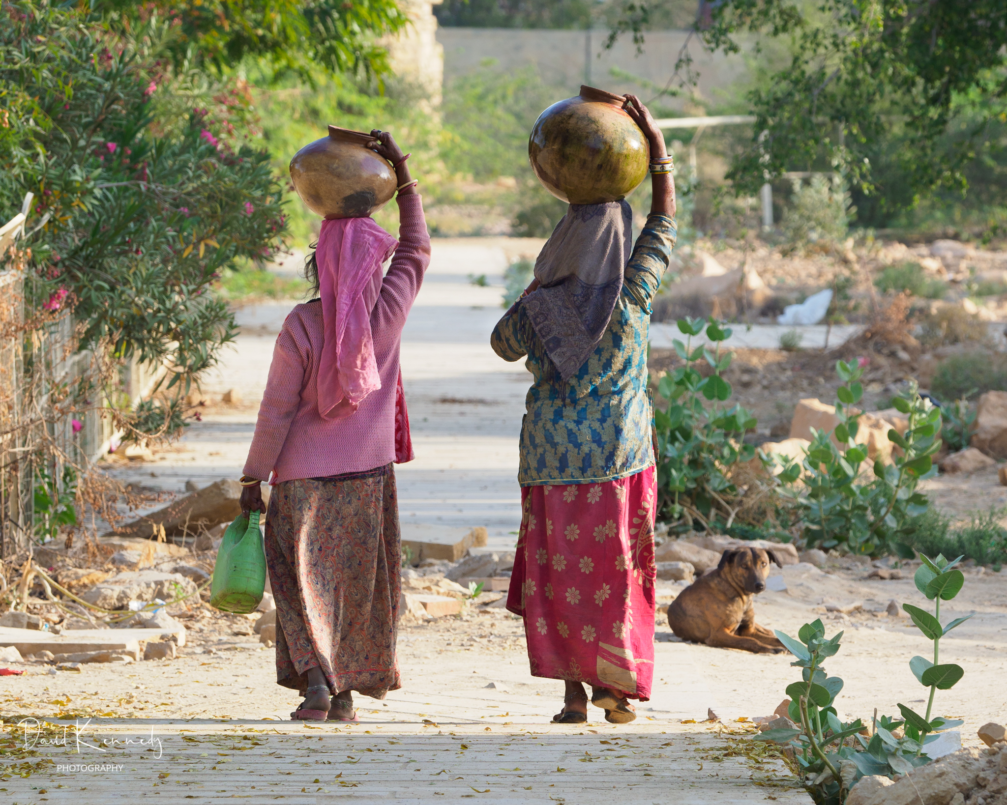 Women carrying bowls of water on their heads