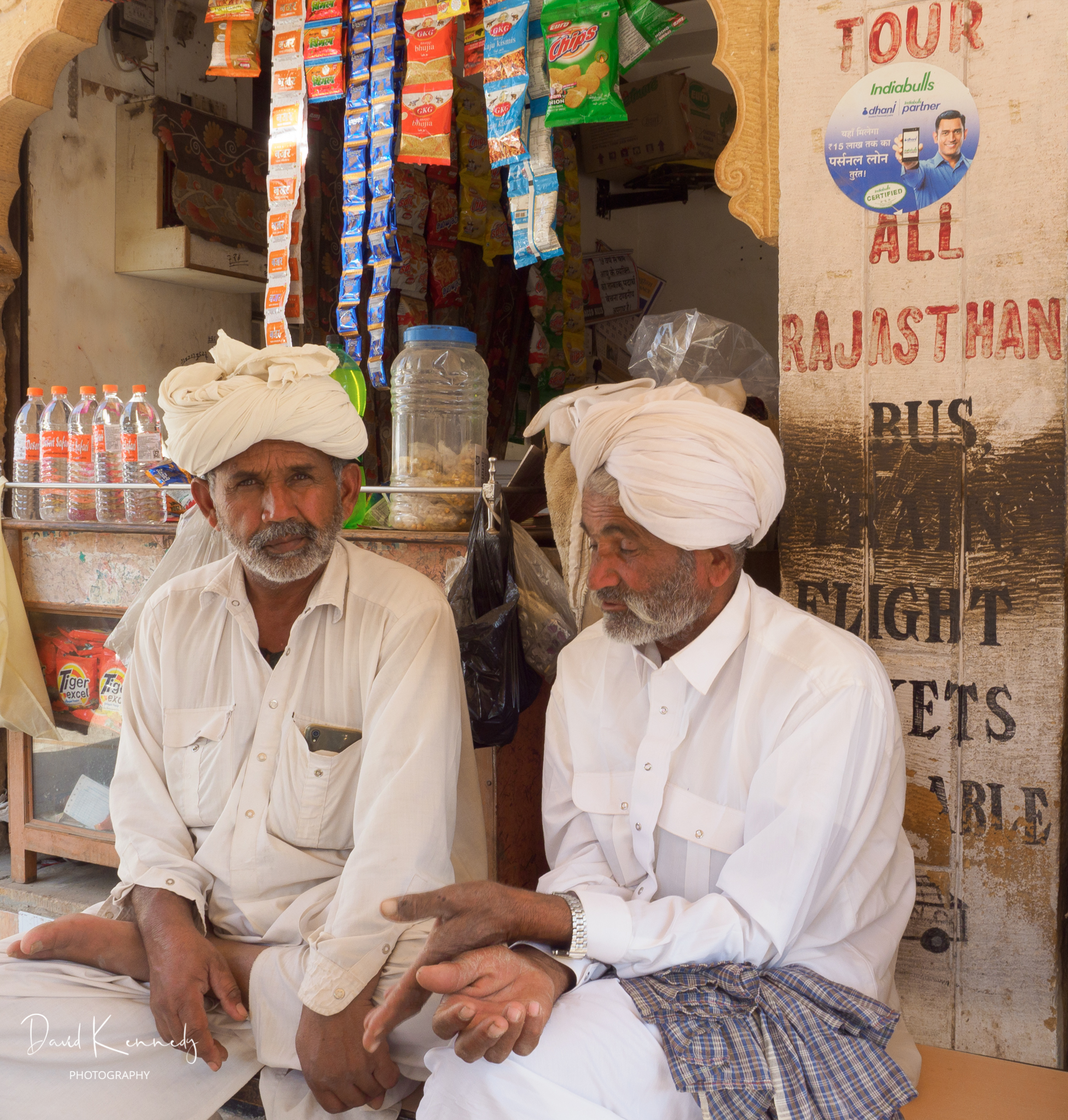 Two Muslim men chatting in a street café in India