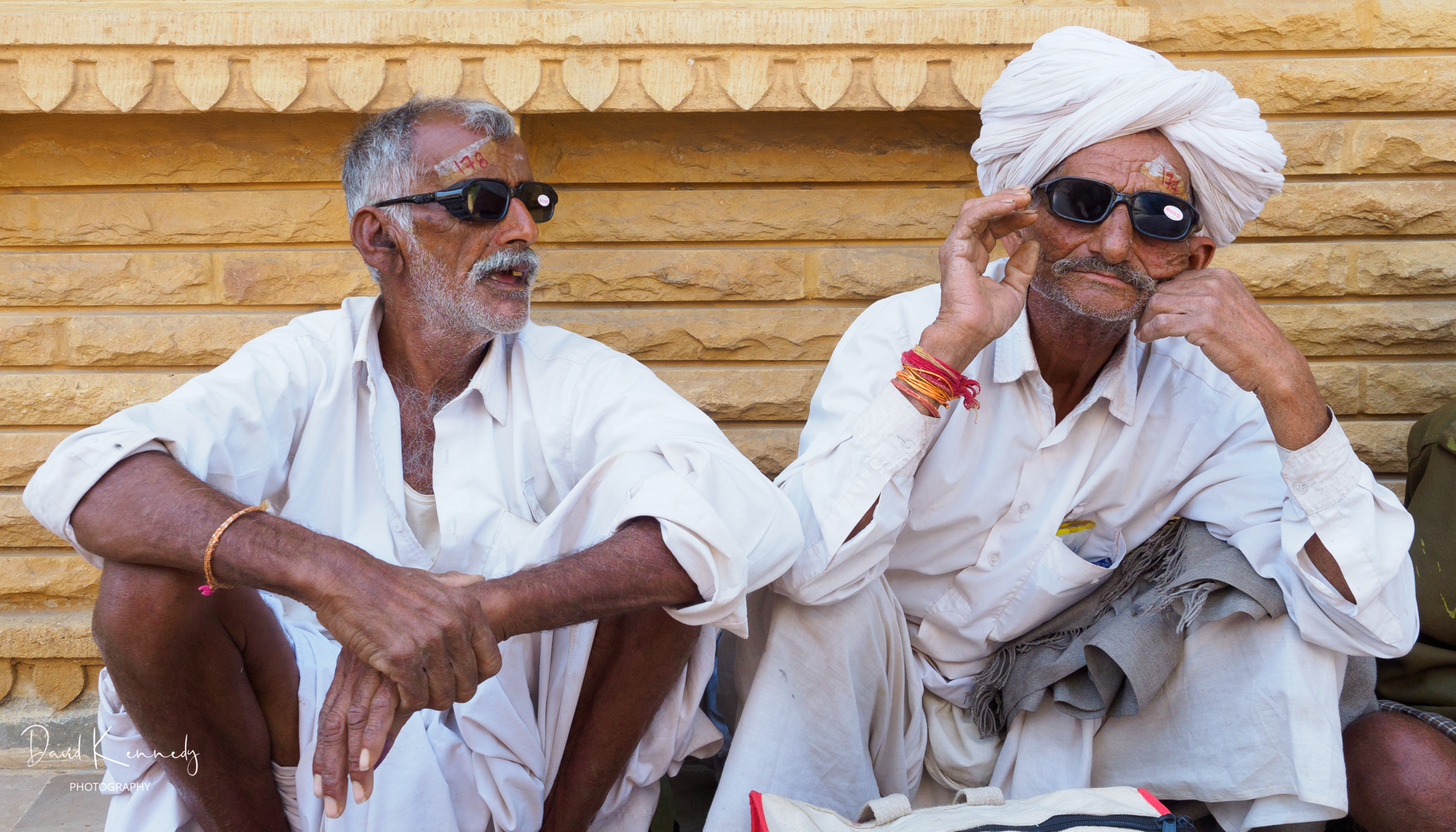Two men waiting outside after cataract procedures to be seen again